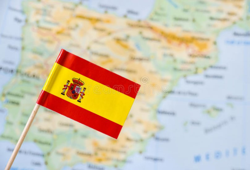 spain-flag-paper-pin-blurry-map-background-61305241